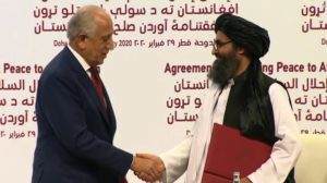 CNN-US.Envoy-Zalmay.Khalilzad-and-Taliban-Terrorists-HandShake-Doha-Qatar-Feb29-2020