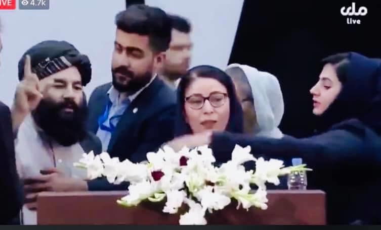 Female delegate, Asila Wardak, redressing mistreatment of another woman delegate interrupted by a Talib using expletives for protesting delegate.